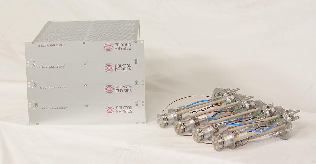 Photo of four 10kV IE-guns (ECR sources) plus their electronics